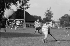 OverHere! (brnpttmn) Tags: park blackandwhite bw irish game film sports sport nikon swinging rodinal fm3a hurling 125 whacking regionalpark harrietisland fomapan arista 105mmf25ais homedeveloping aristaeduultra irishfair harrietislandregionalpark