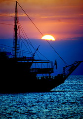 In between day and night (Aster-oid) Tags: ocean blue ship sunsets greece mykonos ih sailships theblues blueribbonwinner athousandwords supershot abigfave colorphotoaward goldenphotographer diamondclassphotographer flickrdiamond flickrdiamondclass ysplix votedthebest excapture diamondexcapture theperfectphotographer thegoldendreams