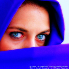 Diamonds. And a touch of rust. (Java Cafe) Tags: blue iris portrait woman girl face closeup lady female scarf interestingness eyes bravo veil hijab vivid stare niqab gaze soe topf200 f200 100v100f interestingness39 i500 fivestarsgallery anawesomeshot colorphotoaward impressedbeauty vividmasters explore15sep07 thebestvivid 2007jhinukchowdhury phoeniximmortal
