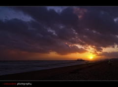 Chasing the Sun (edmundlwk) Tags: uk sunset england sun beach water clouds brighton colours westpier shore canon7d tokina1116mm