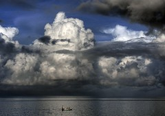 Boat and Approaching Storm - by Bob Jagendorf