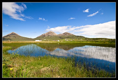 Isle of Skye (ChrisHepburn) Tags: blue sun mountains reflection green ex water clouds lens boats evening isleofskye rice paddy hills filter fields series p portree sigma1020mm cokin ndgrad nikond80 sigmaex1020mmf456 portreehabour