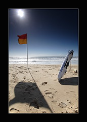 Gone Beach (Garry - www.visionandimagination.com) Tags: shadow sun beach water sand surf oz flag australia wideangle lifeguard explore queensland aus 1022mm sunshinecoast garry supershot searchthebes interestingness48 i500 bestofaustralia visionandimagination wwwvisionandimaginationcom