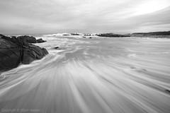 A Rushing Sea (right2roam) Tags: ocean california longexposure sea blackandwhite bw mer beach coast monterey pacific central wideangle peninsula asilomar pointpinos etatsunis  marinesanctuary seascpae       right2roam elijahhassler