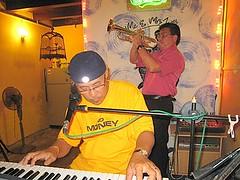 ME & MRS JONES CAFE, JALAN HANG KASTURI (2ND CROSS ST), OLD MALACCA, MALAYSIA - VICTOR ON THE TRUMPET AND HAWK ON THE KEYBOARD. (chankooncheng) Tags: old music tourism me st guests jones cafe cross hanh hawk walk live livemusic off 2nd entertainment malaysia nightlife jalan mrs hang melaka malacca jonker flickrcom kasturi nightspot youtubecom malaccafotos chankooncheng entertainmeng