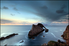 Bow Fiddle Rock (angus clyne) Tags: door longexposure blue light sunset sea wild cliff cloud seascape bird nature water rock night dark island hope gold golden coast scotland spring long arch aberdeenshire angus dusk gull north scottish stack east land moray firth cullen clyne buckie portknockie bowfiddlerock