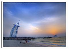 Sunset at Jumairah (Hussain Shah.) Tags: summer tower beach skyscraper d50 hotel al nikon dubai uae sigma arab burjalarab 1020mm hdr 2007 burj alarab impressedbeauty aplusphoto superhearts