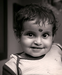 Cutee (cybershots (Subin Paul)) Tags: baby india cute girl monochrome smile canon kid little innocent kerala 400d
