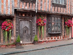 A Crooked Lavenham Town House (saxonfenken) Tags: flowers england geotagged suffolk baskets superhero thumbsup 213 lavenham bigmomma gamewinner babymomma mywinners abigfave ultimateshot wowiekazowie photofaceoffwinner a3b friendlychallenges thechallengefactory yourock1st pregamewinner doorwindoworboth 213house