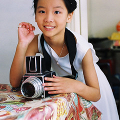 little angel loves hasselblad (* andrew) Tags: portrait slr film zeiss square hongkong 50mm nikon photographer hasselblad carl 100 agfa ultra fm2 planar tung 500cm zf zf50mm planart1450