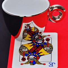 Luck of the Draw (njk1951) Tags: cup reflections playingcard redandblack tazza luckofthedraw jokeriswild mirrorfinishcoffeecup coffeecupandcard neverendingpossibilities