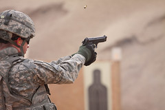 Flying brass (Jake Lester Photography) Tags: soldier army uniform desert boots military iraq helmet gloves pistol target soldiers range 9mm beretta m9 qualification bodyarmor eos50d 70200mmf4lis hescobarriers