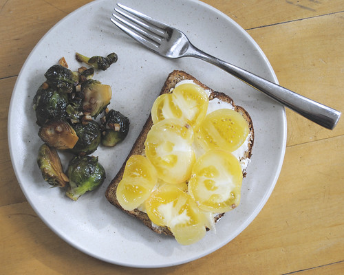 Toast, tomatoes, and Brussels sprouts with lemon and garlic