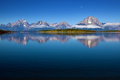 "Grand Tetons reflecting in Jackson Lake (IronRodArt - Royce Bair (""Star Shooter"")) Tags: park travel blue vacation sky panorama usa moon mist mountain lake mountains reflection tourism nature water beautiful beauty clouds america landscape scenery view hole natural outdoor background scenic vivid peaceful tranquility grand jackson clear national western summit vista wyoming peaks teton majestic range tranquil grandeur"
