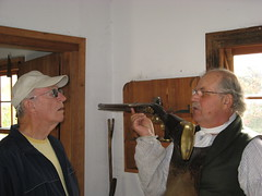 Dad checks out an old rifle Photo
