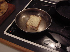 one sandwich in pan