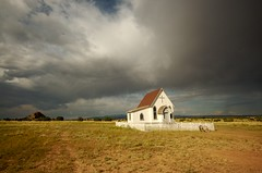 Under the big sky (wycombiensian) Tags: newmexico santafe clouds chapel western glowering festval eavesmovieranch thirstyear imagesoftheworld thirstyear07