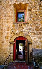 Mission door (ccmonty) Tags: door blue red church window santabarbara stone wall reflections skulls interestingness explore mission crossbones lightroom missionsantabarbara skullsandcrossbones