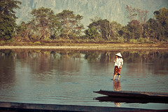 Washer Woman (theGentleman) Tags: family people woman baby mountain reflection tree 2004 rural canon river boat asia southeastasia child photos skirt cheeky 55mm valley laos washing vien isolated gentleman washer hitch the d300 vang mekhong vangvien thegentleman cheekyphotoscouk