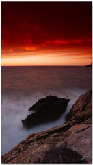 rock in storm (chris frick) Tags: sunset seascape storm rocks tripod wideangle filter frame drama 169 mallorca tobacco contrasts gradients cokin sooc 8nd a550 remoteshuttercontrol chrisfrick bensdavall 8gnd sonyalpha550 topazdenoise5 rockinstorm