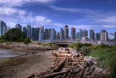 Deadman's Island Bridge, Vancouver (Thad Roan - Bridgepix) Tags: bridge blue trees winter sky canada beach water skyline vancouver clouds buildings sand rocks bc military navy logs bridges brush wikipedia stanleypark olympics condos naval hdr coalharbour bridging 200707 deadmansisland bridgepixing bridgepix abigfave