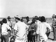 Archaeologist / Historian Raymond Mauny negotiates a price for boats to take us to the cemetery island near Fadiouth, Senegal (West Africa) (gbaku) Tags: africa west water cemetery historian african westafrica afrika senegal africain afrique cimetire africaine archaeologist westafrican archaeologists afrikas
