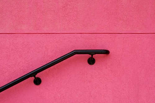 pink wall with railing