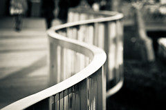 Curvy rail (Marquisde) Tags: macro canon vanishingpoint dof bokeh curves australia melbourne 100mm southbank depthoffield urbannature 7d rails handrail footpath f28 canonef100mmf28lisusmmacro