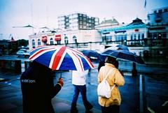 summers day (lomokev) Tags: street people rain umbrella lomo lca xpro lomography crossprocessed xprocess brighton lomolca british agfa unionjack jessops100asaslidefilm agfaprecisa lomograph agfaprecisa100 cruzando briton precisa jessopsslidefilm file:name=070605lomolca20