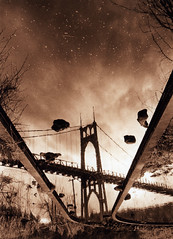 Even in an upside down world, a bridge is still a bridge (Zeb Andrews) Tags: bw sepia architecture oregon 35mm reflections portland upsidedown bridges pacificnorthwest pdx nikonfm2 fujineopan400 stjohnsbridge suspensionbridges blueribbonwinner bluemooncamera historicbridges zebandrews abigfave artlibre zebandrewsphotography