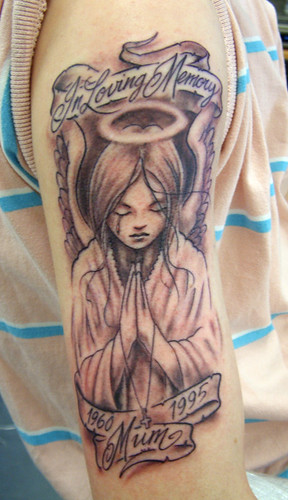 grey weeping angel Tattoo by The Tattoo Studio