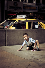 Racing (theGentleman™) Tags: road family boy red portrait people urban baby playing 2004 car yellow truck canon toy thailand holding asia southeastasia 300d sitting child photos taxi south nick young cook rail cheeky east 55mm shorts roadside staring gentleman payne taximeter the thegentleman mywinners cheekyphotoscouk