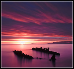 Slarupprs  Skagafiri (Arnar Bergur) Tags: ocean old blue sunset sea orange water clouds sunrise landscape iceland long exposure ship purple stranded sland skagafjrur ndfilter ernan adventuretravel perfectsunsetssunrisesandskys