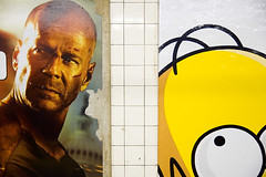 DSC_8275 (dogseat) Tags: men eye yellow ads movie subway tile diptych funny metro pair famous rad bald simpsons advertisement tiles eyeball heads posters mta thesimpsons gothamist forehead homersimpson lean brucewillis baldman diehard gothamistlove