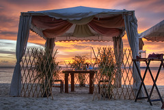 Private Service (Shutterscript) Tags: ocean wedding sunset sea plant beach water dinner table boat sand chairs silverware bamboo aruba hdr