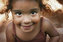 Earthen Princess... (carf) Tags: poverty girls brazil streets girl smile smiling brasil kids children hope kid eyes community education support child earth forsakenpeople esperana social impoverished underprivileged altruism change shanty educational favela development prevention outreach earthen atrisk changemakers mundouno everyoneachangemaker stiojoaninha