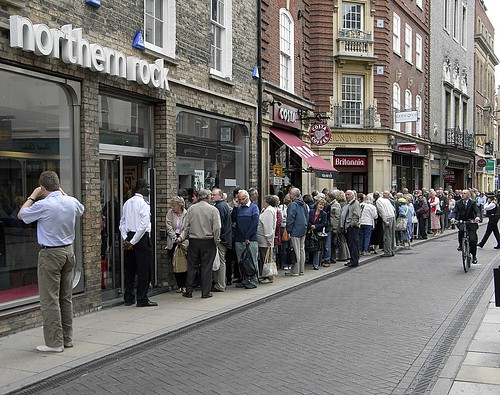Cambridge - Customers of Northern Rock waiting patiently to withdraw their savings.