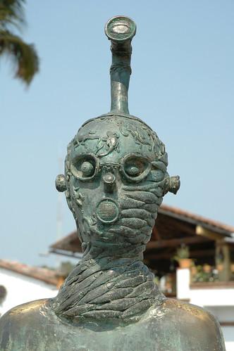 Metal fish man, periscope, sculpture, Puerto Vallarta, Mexico by Wonderlane