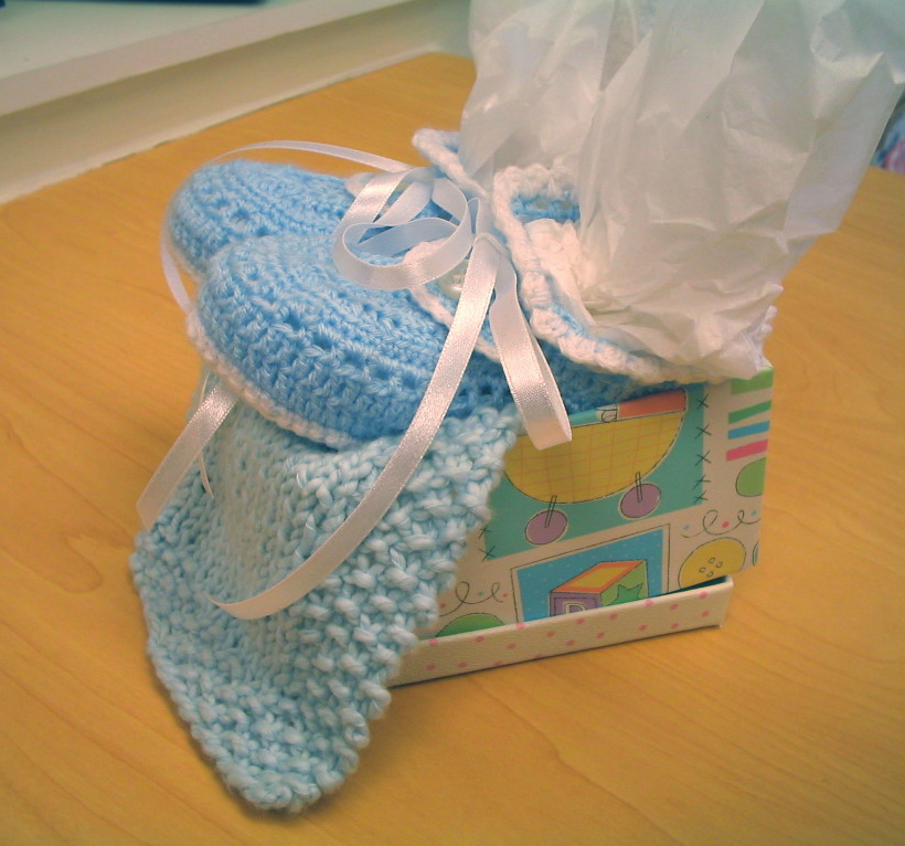 crocheted baby booties and washclth