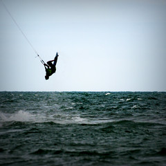 Trapeze - Kite surfing @ Freshwater Bay, Isle of Wight (s0ulsurfing) Tags: ocean sea kite beach water silhouette sport danger wow fun island bay coast cool scary play action circus board awesome acid extreme ps surfing kitesurfing coastal isleofwight coastline kitesurf isle wight aktion 2007 freshwater kitesurfer freiheit kitesurfen freshwaterbay abenteuer trapexe s0ulsurfing aplusphoto coastuk tomcourt