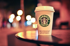 Starbucks (Jaleeesa) Tags: street pink blue black paris france hot streets green cup coffee colors night circle logo table restaurant evening nikon focus europa europe purple tea drink bokeh circles f14 background icon starbucks drinks round frankrijk avond tones parijs yello thee tafel achtergrond 30mm d90