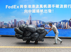express delivery (jobarracuda) Tags: lumix hongkong billboard cart fedex kowloon fz50 garbageman oceanterminal panasoniclumix dmcfz50 aplusphoto jobarracuda garbagecart