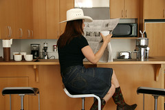 urban cowgirl (Veronika Lake) Tags: selfportrait home me self myself reading published cowgirl cowboyhat globeandmail cowboyboots calgarystampede veronikalake explored thankgoodness lastdayofstampeding 2yearflickanniversary