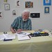 Caroll Spinney signing a print