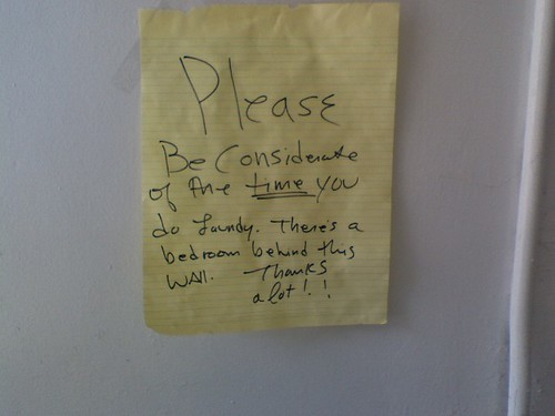 Please Be Considerate of the TIME you do laundry. There's a bedroom behind this door. Thanks a lot!!