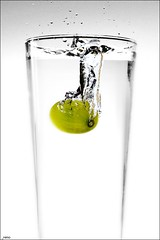 splash (remography) Tags: color green water fruit cutout photo nikon wasser foto d70s utata grn splash minimalism nikkor farbe frucht grape emptyspace justatest spritzer traube fruitsplash twtme swissphotographer ~whiteground