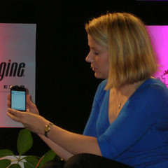 Marissa Mayer, Google's VP of Search Product & User Experience, demos her iPhone at SES Conference.