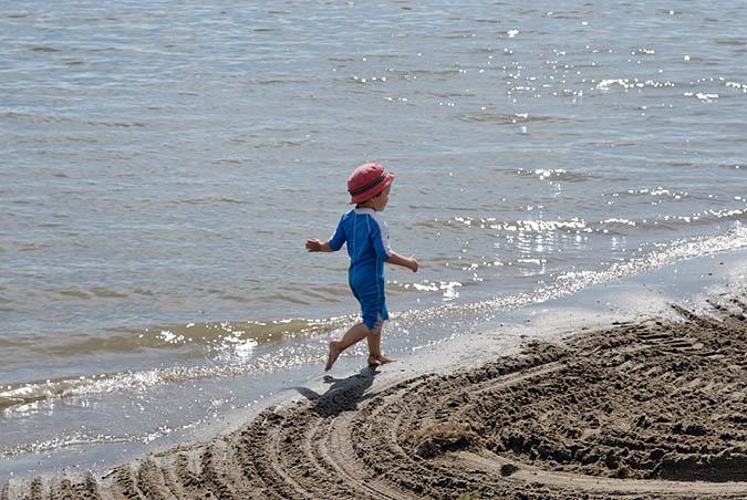 Evan running by water4453