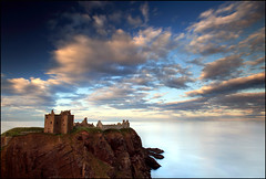 Castles in the sky (angus clyne) Tags: world ocean new old blue light red sea cliff cloud sun moon seascape reflection castle beach water rock stone set silver landscape island gold bay coast scotland high haze long exposure angle bright angus tide horizon low north wide scottish calm east beam pebble shore hour rig oil sail cave 20mm rise dri dunnottar clyne colorphotoaward vertorama canon5dmarkii peregrino27newvision