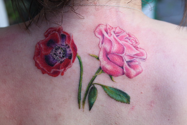 poppy flower and rose tattoo by Mirek vel Stotker